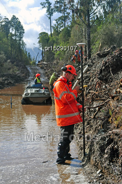 Man Surveying The Location Of Geophones For A Seismic Reflective Survey On The West Coast Of New Zealand Stock Photo