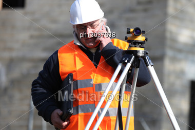 Man Surveying Site Stock Photo