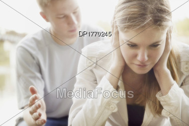 Man Talking To Woman, She Dosen't Want To Listen Stock Photo