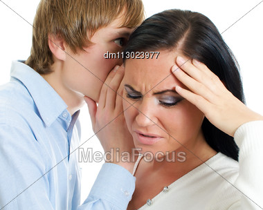 Man Telling Terrible Secret To A Woman. Isolated On White. Stock Photo