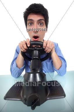 Man Testing A Car Driving Simulator Stock Photo