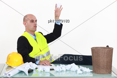 Man Throwing Paper Stock Photo