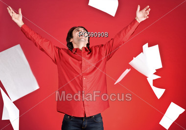 Man Throwing Papers Up in the Air Stock Photo
