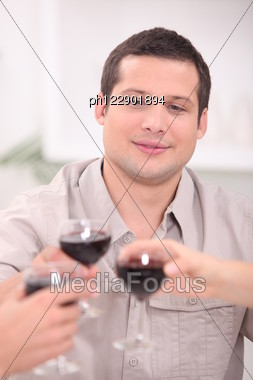 Man Toasting With Wine Stock Photo