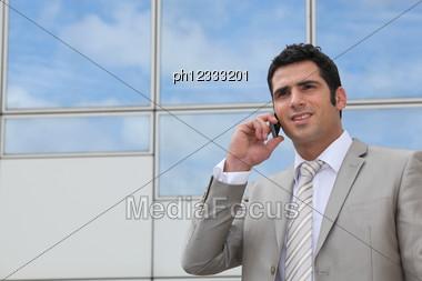 Man Using A Cellphone Stock Photo