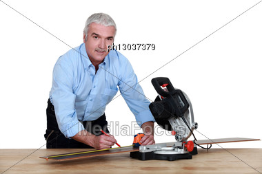 Man Using A Mitre Saw Stock Photo
