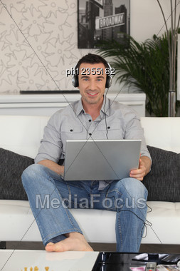Man Watching A Movie On Laptop Stock Photo