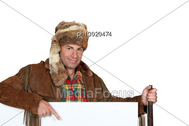 Man Wearing A Fur Hat Stock Photo