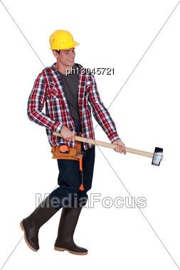 Man Wielding Sledge-hammer Stock Photo