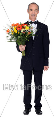 Man With A Bouquet Of Flowers Stock Photo