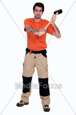 Man With A Sledgehammer. Stock Photo