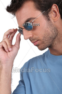 Man With Blue Sunglasses Stock Photo