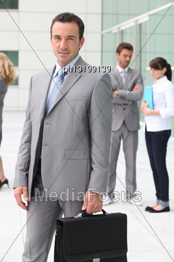 Man With Briefcase Outside Office Building Stock Photo