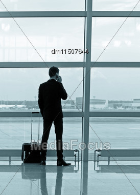 Man With Luggage In The Airport Stock Photo