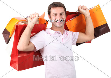 Man With Plenty Of Shopping Bags Stock Photo