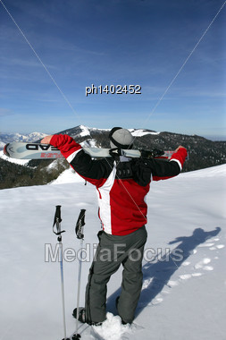 Man With Skis On His Back Stock Photo
