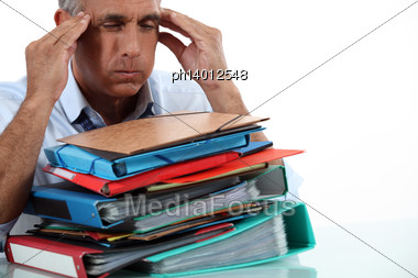 Man With Stack Of Work Stock Photo