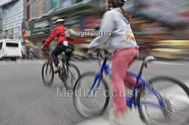 Man And A Woman Street Bike Riders In Motion Blur Stock Photo