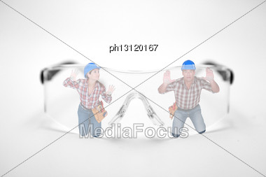 Man And Woman Stuck Behind Giant Protective Goggles Stock Photo
