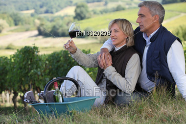 Man And Woman Tasting Wine In A Vineyard Stock Photo