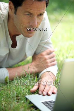 Man Working On The Grass Stock Photo