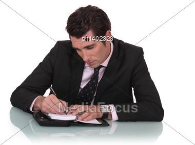 Man Writing On A Diary Stock Photo