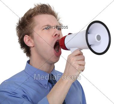 Man Yelling Into A Megaphone Stock Photo