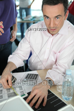 Manager Sitting At His Desk Stock Photo