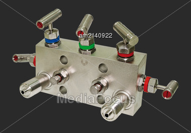 Manifold Block For The Differential Sensor. Isolated On A Dark Gray Background Stock Photo