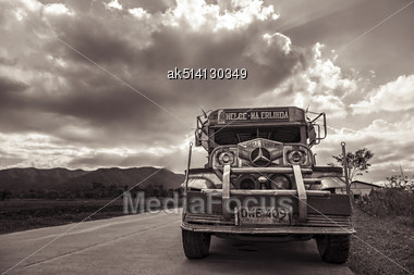 MANILA, PHILIPPINES - MARCH 15: Jeepney On The Road On March, 15, 2013, Manila, Philippines. Jeepney Is A Most Popular Public Transport On Philippines Stock Photo