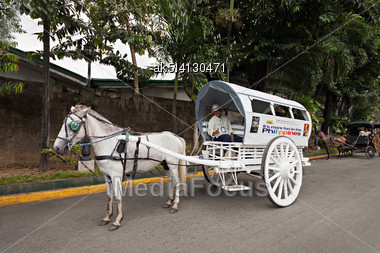 MANILA, PHILIPPINES - MARCH 18: Horse With Carriage In Intramuros On March, 18, 2013, Manila, Philippines. Intramuros Is The Oldest District And Historic Core Of Manila, Capital Of The Philippines Stock Photo
