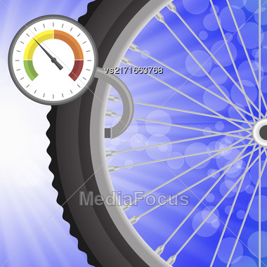 Manometer And Part Of Bicycle Wheel On Bllurred Bllue Rays Background. Measuring Pressure In The Wheel Stock Photo