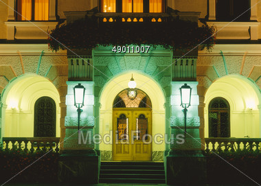stock photo mansion entrance lights at night image 49011007