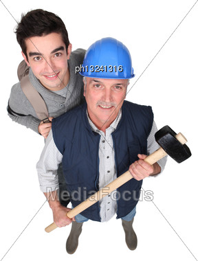 Manual Worker And His Grandson Stock Photo