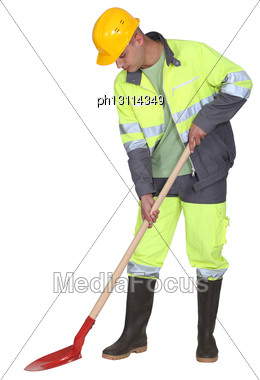 Manual Worker With Spade Stock Photo