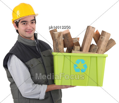 Manual Working Holding Crate Of Timber To Be Recycled Stock Photo
