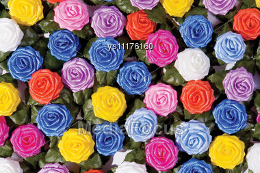 Many-coloured Plastics Roses On A Table Stock Photo
