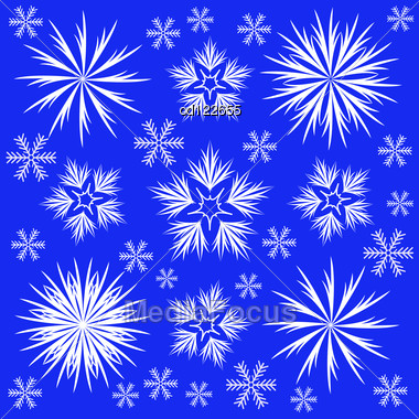 Many Different White Snowflakes On A Blue Background Stock Photo