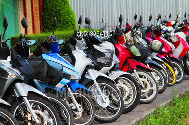 Many Motobikes On The Parking, Thailand Stock Photo