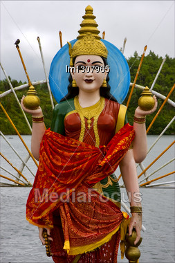 Marble Wood Statue Of A Hinduism Women Shiva Vishnu Brahma In A Temple Near A Lake In Mauritius Africa Stock Photo