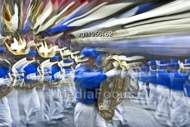 Marching Band On The Street In Motion Blur Stock Photo