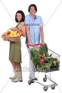 Market Vs Supermarket: Couple Shopping For Fruit And Vegetables Stock Photo