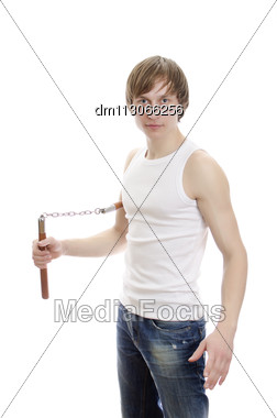 Martial Art. Man With Nunchucks. Isolated Over White Stock Photo