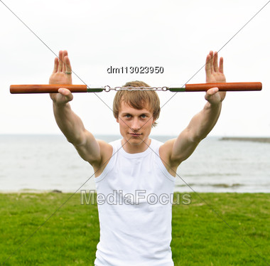 Martial Arts: Man With Nunchaku Stock Photo