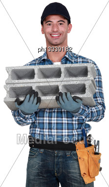 Mason Carrying Breeze Block Stock Photo