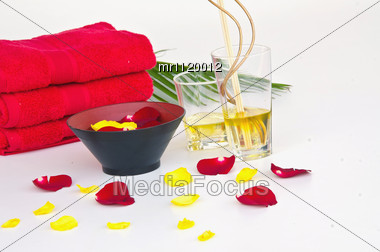 Massage Oil Red Towels And Flowers Stock Photo MR1120012 - Royalty