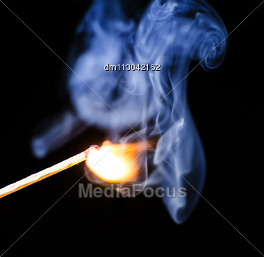 Match Ignition With Smoke Over Black Background Stock Photo