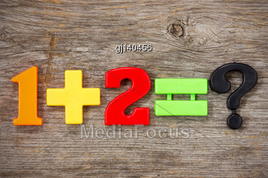 Math Example With Color Numbers On A Wood Background Stock Photo