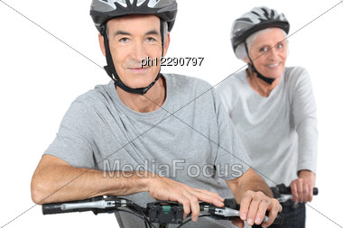 Mature Couple Biking. Stock Photo