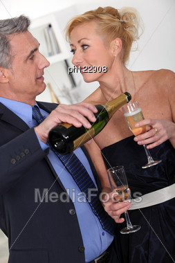 Mature Couple Drinking Champagne Stock Photo